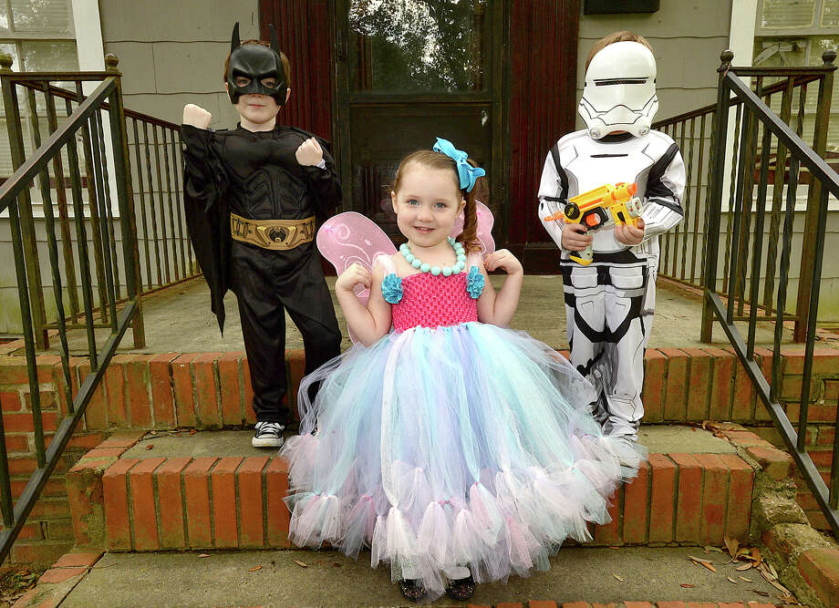 From left, Jude Hyde, 6, Violet, 3, and Gavin, 4, will be dressing up for Halloween this year after some scrambling to get together the funds necessary to buy costumes. Although Amanda Hyde says their family didn't have any damage to their home, flooded roadways kept her from getting to work, costing them three weeks of pay. The loss of income has made money tight, and she says she was just barely able to afford getting them the costumes they wanted. Photo taken Friday, October 27, 2017 Kim Brent/The Enterprise Photo: Kim Brent / BEN