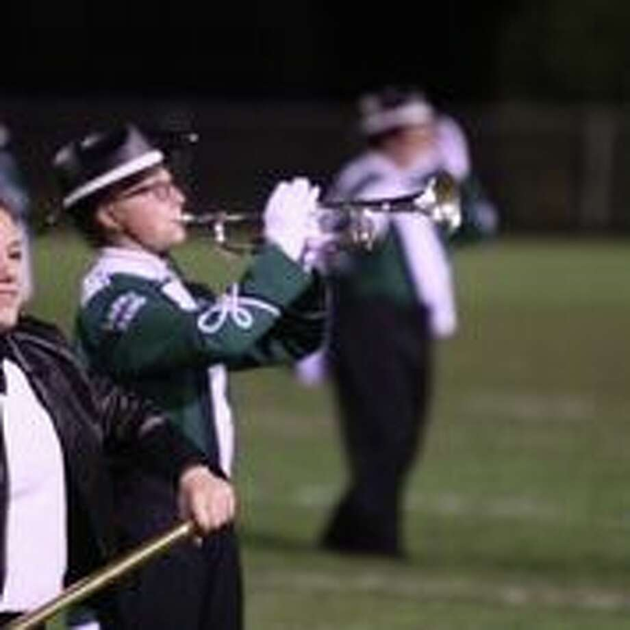 The Laker Marching Band entertains the crowd during Friday Night's playoff victory against Flint Hamady. Photo: Coulter Stuart/For The Tribune