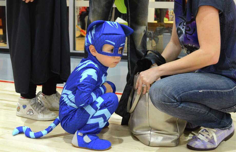 Aaron Aalto, 3, of New Canaan, gets ready to start trick-or-treating at the Chamber of Commerce's annual Halloween Parade, held at the New Canaan YMCA, Sunday, Oct. 29, 2017, in New Canaan, Conn. Photo: Jarret Liotta / For Hearst Connecticut Media / New Canaan News Freelance