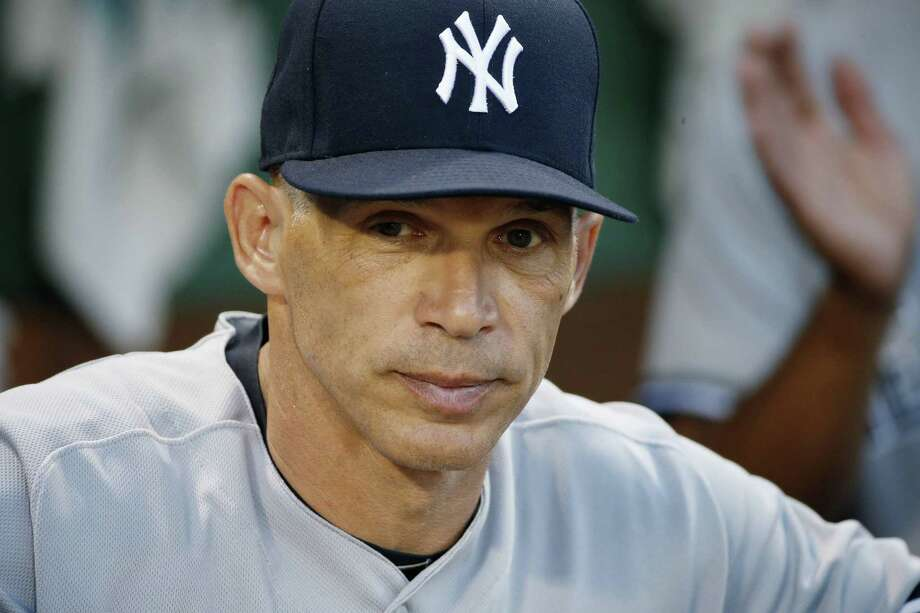Yankees manager Joe Girardi stands in the dug out before the second game of a baseball doubleheader against the Red Sox in Boston. The Yankees announced Oct. 26, 2017, that Girardi will not return to the team for the 2018 season. Photo: Michael Dwyer /Associated Press File Photo / Copyright 2017 The Associated Press. All rights reserved.