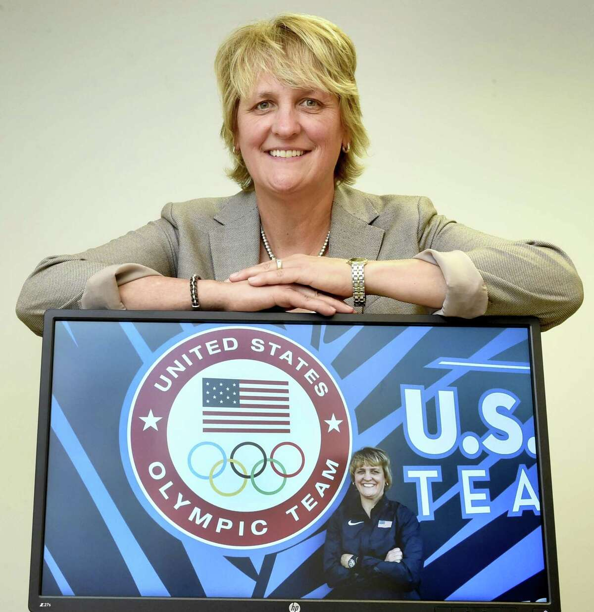 Bonnie Edmondson, Associate Professor of School Health Education, a with a photo of herself during the July 2016 U.S. Track and Field Olympic Trials in Eugene, Oregon.