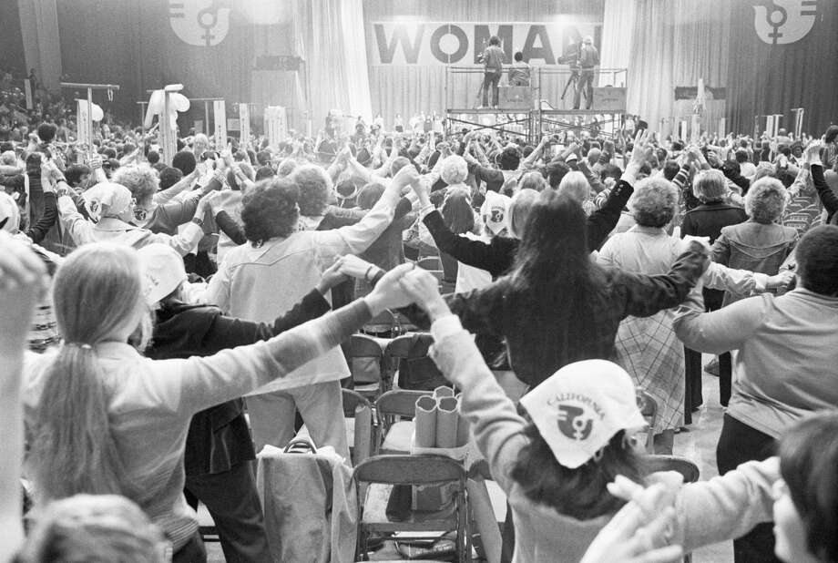 Women Join Hands at National Women's Conference (Original Caption) 11/21/1977- Houston, TX- After conservatives staged a walk-out near the end of the historic four-day National Women's Conference, the remaining majority of delegates joined hands in a symbolic show of unity as the conference was adjourned 11/21 after some 25 feminist proposals were passed. Photo: Bettmann / Getty Images