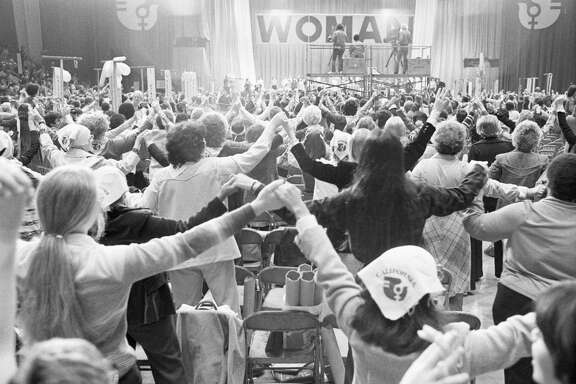 Women Join Hands at National Women's Conference (Original Caption) 11/21/1977- Houston, TX- After conservatives staged a walk-out near the end of the historic four-day National Women's Conference, the remaining majority of delegates joined hands in a symbolic show of unity as the conference was adjourned 11/21 after some 25 feminist proposals were passed.