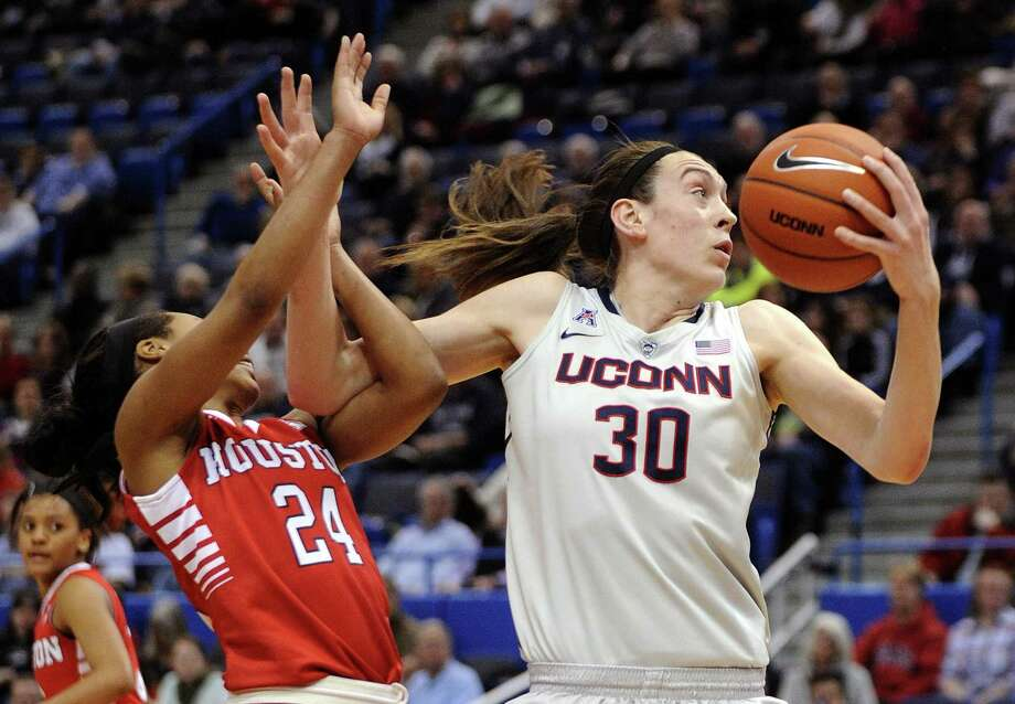 FILE - In this Feb. 17, 2015, file photo, Connecticut's Breanna Stewart (30) is fouled by Houston's Mariah Mitchell (24) during the first half of an NCAA college basketball game in Hartford, Conn. Stewart was selected as The Associated Press women's college basketball player of the year, Saturday, April 4, 2015.  (AP Photo/Fred Beckham, File) Photo: Fred Beckham / AP / AP