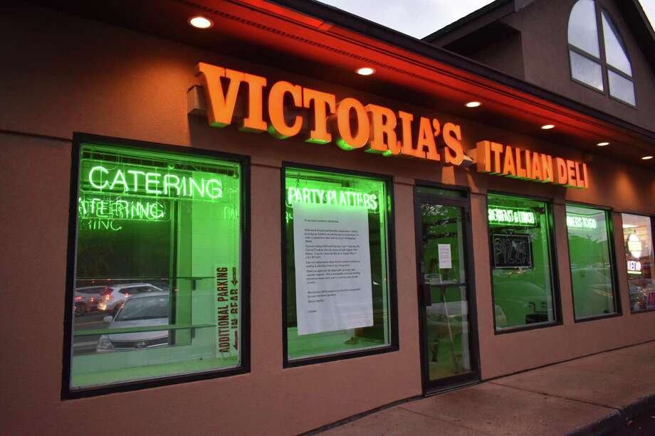 A sign announces the closure of Victoria's Italian Deli as of October 2017 at 247 Connecticut Ave. in Norwalk, Conn. Owner Cristina Colimitra plans to continue a Catering by Victoria business in partnership with the owner of Angela Mia Bakery at the same Connecticut Avenue plaza. Photo: Alexander Soule / Hearst Connecticut Media / Stamford Advocate