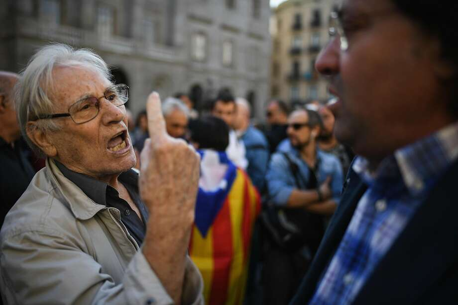 Advocates for Catalan independence and pro-union supporters confront each other in Barcelona, Spain. Photo: Jeff J Mitchell, Getty Images