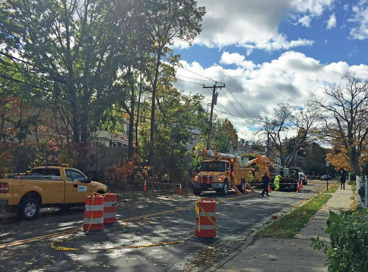 Crews work to repair power line damage on Lowe Street in South Norwalk.