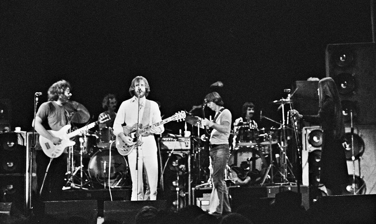 In this May 8, 1977 photo provided by GDBartonHall1977.com, the Grateful Dead perform in a field house at Cornell University in Ithaca, N.Y., in what would become one of the group's most fabled shows. From left are Jerry Garcia, Bill Kreutzmann and Bob Weir, Phil Lesh, Mickey Hart and Donna Godchaux. (Lawrence Reichman/GDBartonHall1977.com via AP)
