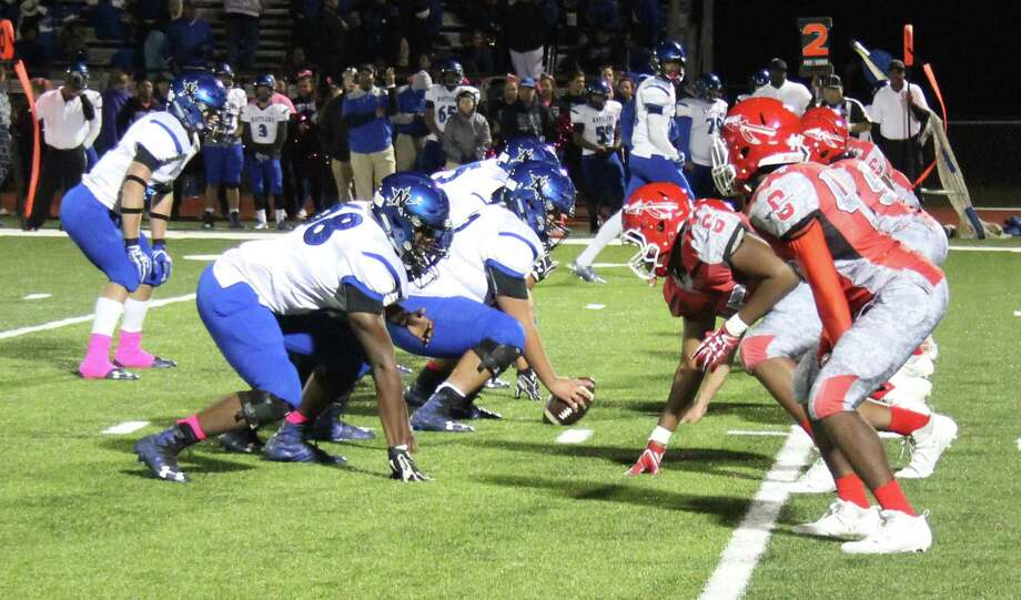 The Cleveland Indians (right) play defense against the Navasota Rattlers (left) during their Oct. 27 football game. Photo: Jacob McAdams
