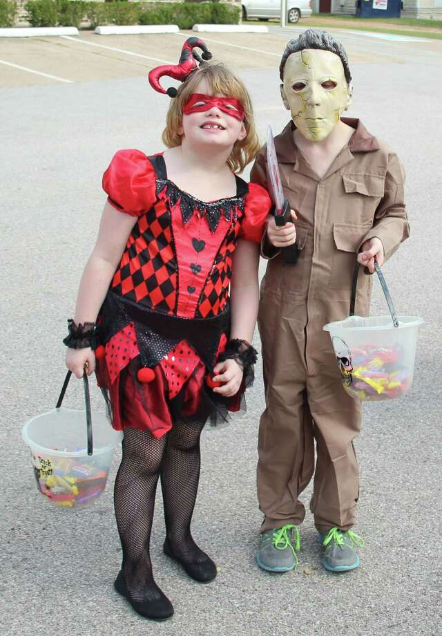 Haley Opperman (left), who is dressed as Harley Quinn and Harley Opperman (right), who is dressed as Michael Myers have finished gathering candy at the Trick or Treat around the Square event. Photo: Jacob McAdams