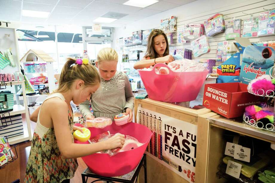 Kate, left, Maggie and Grace look through bins of squishies at Chillybear in Greenwich. Photo: Kyle Michael King / For Hearst Connecticut Media / Hearst Connecticut Media Group Freelance