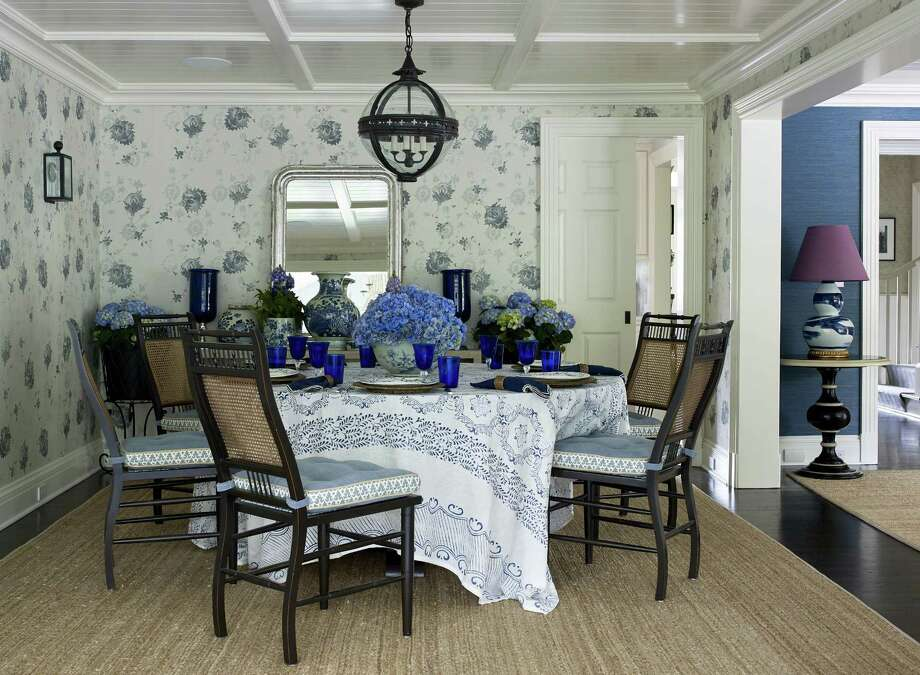 "In this space designed by Greenwich designer Lee Ann Thornton a purple lamp adds verve to a blue-and-white room. The wallpaper, an ""all-over print,"" is a new design, but feels vintage. Also in the mix, a square tablecloth feels modern on a round table. Photo: Francesco Lagnese / Contributed Photo / © Francesco Lagnese 2017"