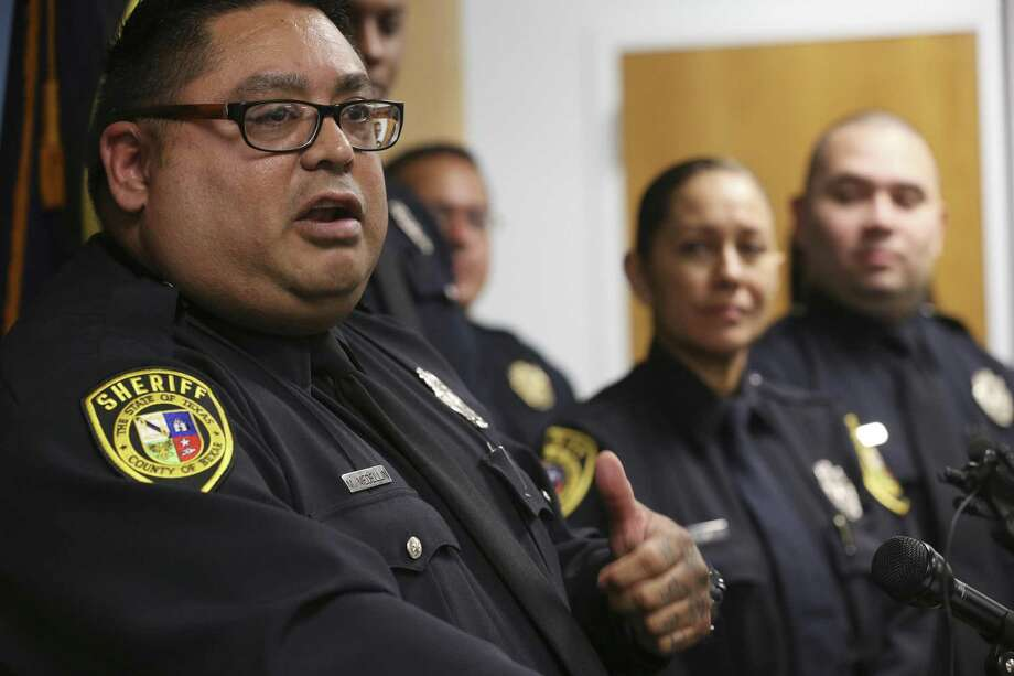 Bexar County sheriff's Deputy Manuel Medellin addresses questions about the Detention Mental Evaluation Team. Photo: Jerry Lara / San Antonio Express-News / San Antonio Express-News