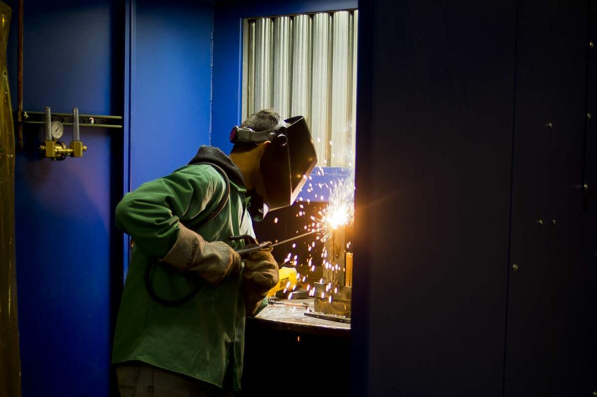 Truman Webb of Coleman, 18, works on a project during a welding course provided by the Associated Builders and Contractors Greater Michigan Chapter on Thursday, Oct. 26, 2017 in Midland. (Katy Kildee/kkildee@mdn.net)