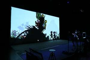 """The view of the shadow puppetry from backstage in """"Feathers of Fire: A Persian Epic,"""" produced by Fictionville Studio and Banu Productions."""