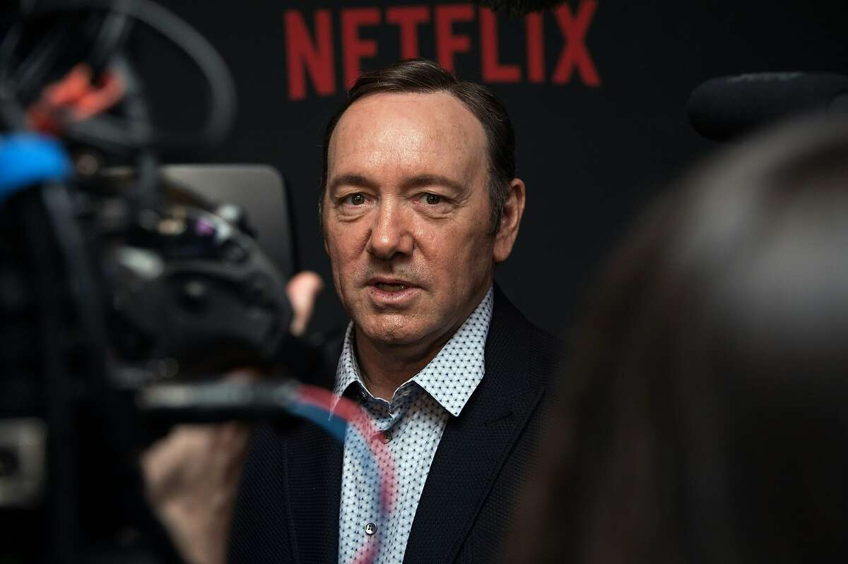 """This file photo taken on February 23, 2016 shows actor Kevin Spacey arriving for the season 4 premiere screening of the Netflix show """"House of Cards"""" in Washington, DC."""