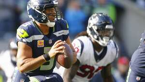 SEATTLE, WA - OCTOBER 29: Quarterback Russell Wilson #3 of the Seattle Seahawks looks to pass against the Houston Texans at CenturyLink Field on October 29, 2017 in Seattle, Washington. (Photo by Jonathan Ferrey/Getty Images)