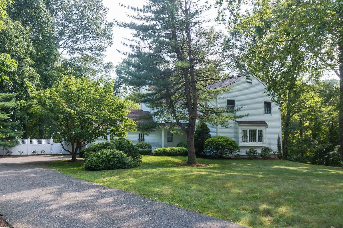 At the end of a long cul-de-sac in the northern part of town a white colonial house sits on a 1.36-acre property at 40 Timber Top Trail.