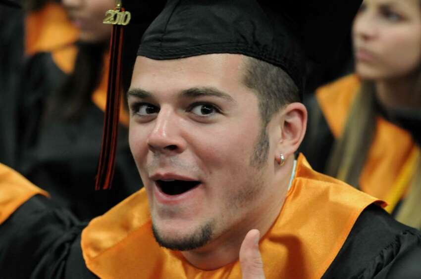 Ridgefield High School graduate Drew Arcoleo gives the thumbs-up after receiving his diploma during the commencement ceremony on Friday June 25, 2010 at the Western Connecticut State University's O'Neill Center.