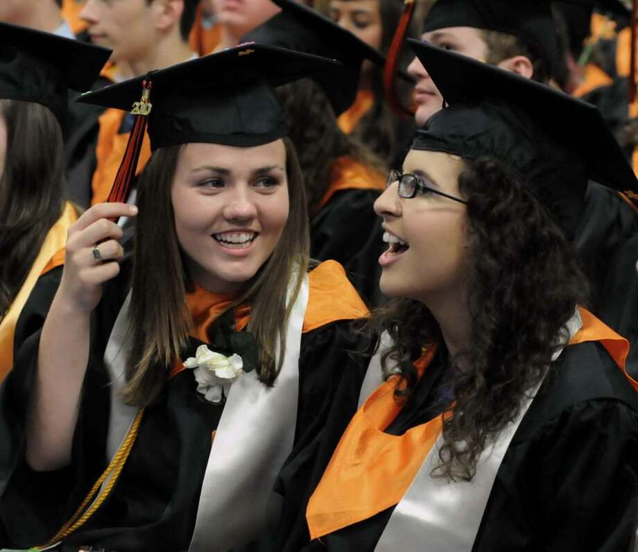 Ridgefield High School graduates Mary Shaw, left, and Brittany Levesque happily chat after receiving their diplomas during their graduation ceremony at the Western Connecticut State University's O'Neill Center on Friday June 25, 2010. Photo: Lisa Weir / The News-Times Freelance