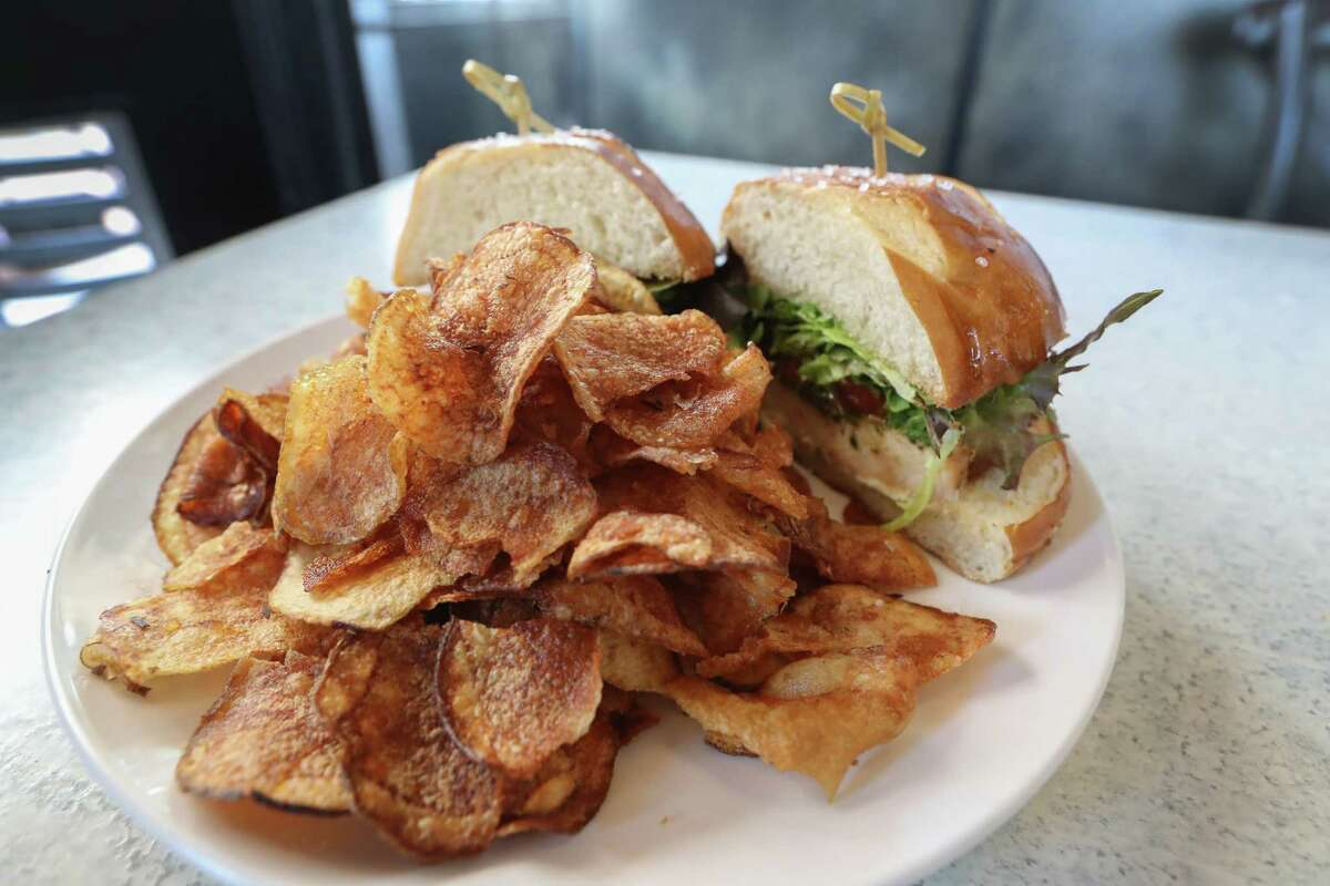 Grilled p[esto chicken sandwich with house chips at Dish Society 12525 Memorial Dr.