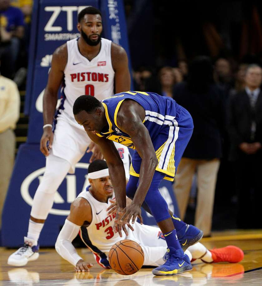 Draymond Green (23) comes up with a rebound ahead of Tobias Harris (34) in the fourth quarter as the Golden State Warriors played the Detroit Pistons at Oracle Arena in Oakland, Calif., Sunday, October 29, 2017. The Pistons defeated the Warriors 115-107. Photo: Carlos Avila Gonzalez, The Chronicle
