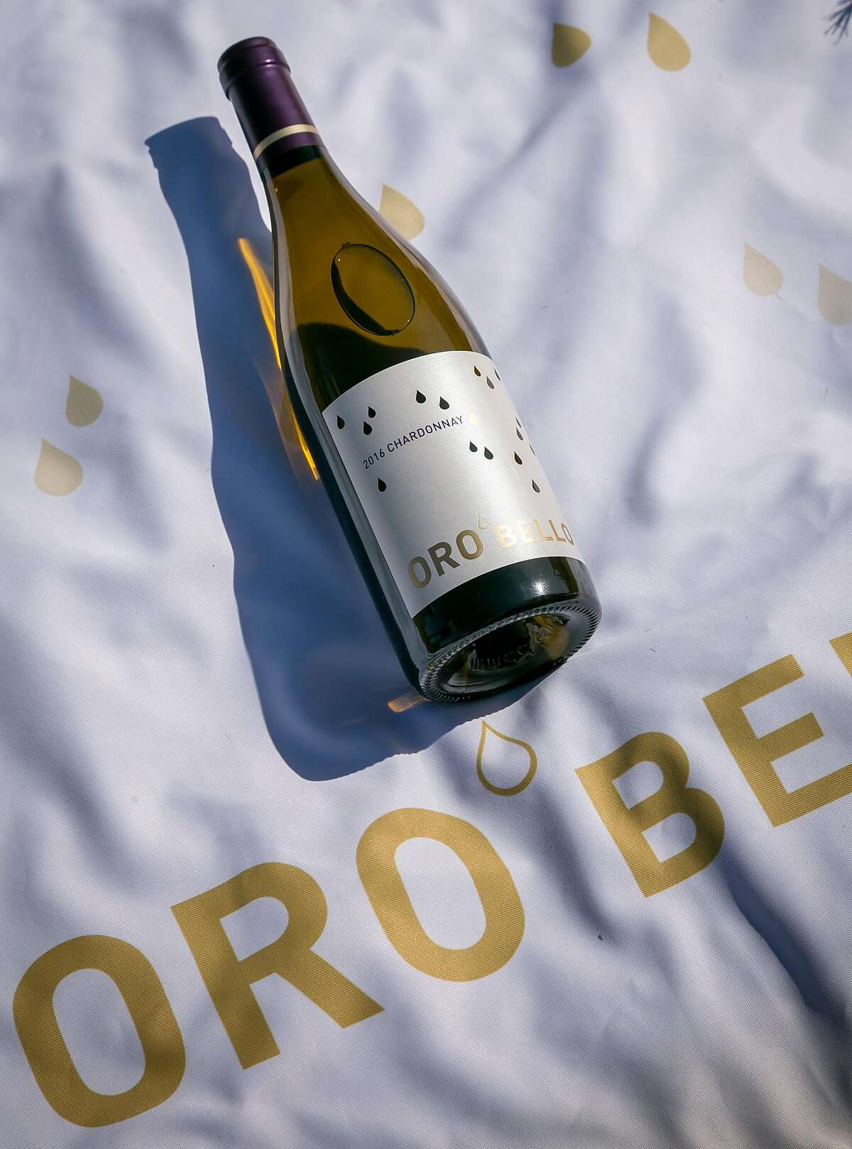 Marketing materials for Atlas Wine Co., whose lineup includes the $17.99 Oro Bello Chardonnay.