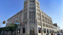 The San Antonio Express-News' headquarters building at 301 Avenue E is being listed for sale. The newspaper moved into the building in 1929.