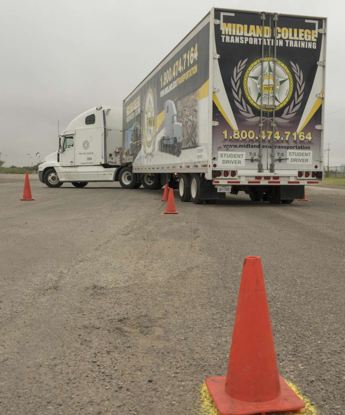 FILE PHOTO: Students practice backing up an 18-wheeler between coneson Oct.4at Midland College trucking school.