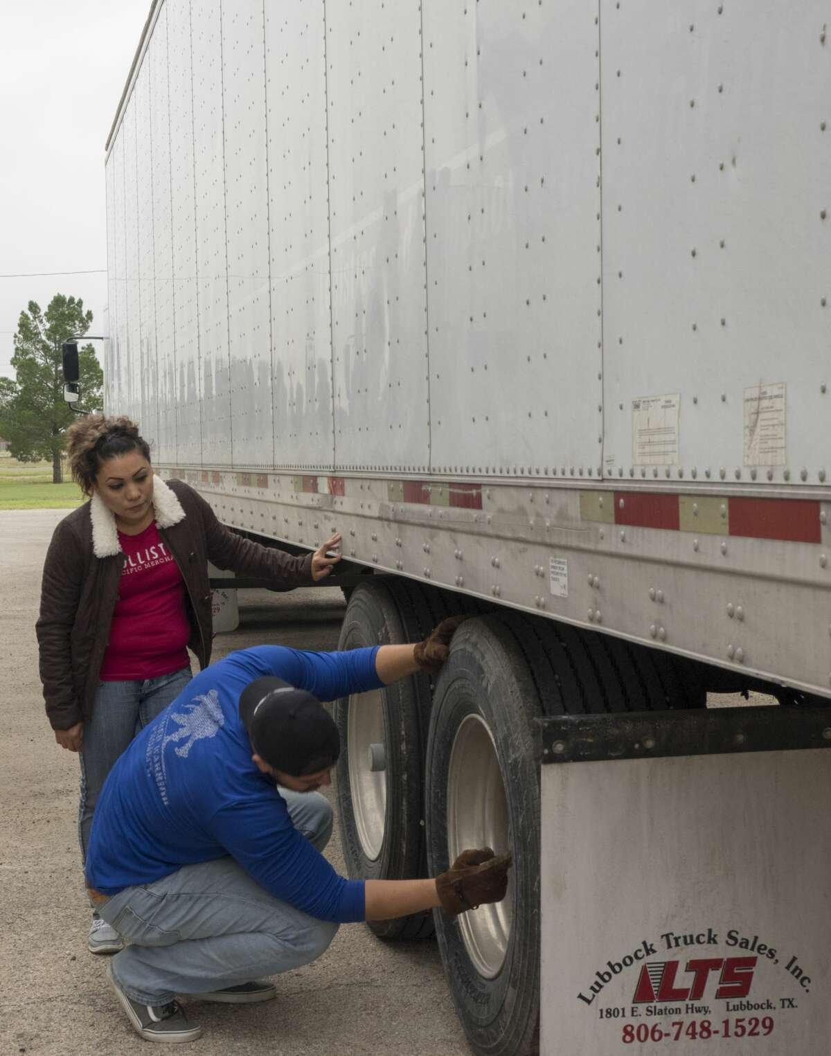 FILE PHOTO:Edwin Armendariz and Erika Silva do the walk-around to check the entire truck on Oct.4 at Midland College trucking school.