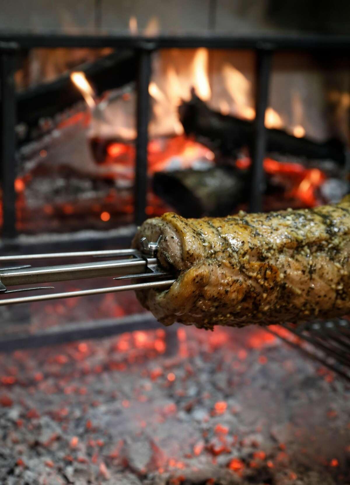 Pork roasts in an open oven at Meraki Market on Thursday, Oct. 19, 2017 in San Francisco, Calif.