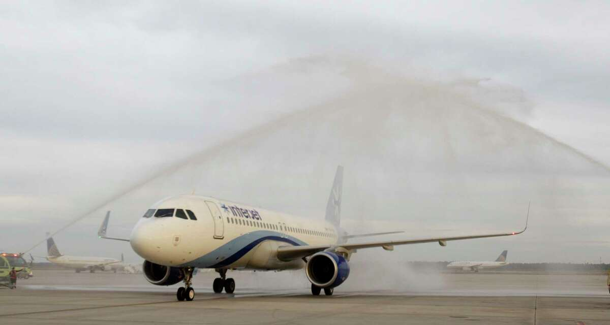An Interjet plane is given a water cannon salute after its inaugural arrival at Bush Intercontinental Airport from Monterrey, Mexico Thursday, Oct. 23, 2014, in Houston. ( Melissa Phillip / Houston Chronicle )