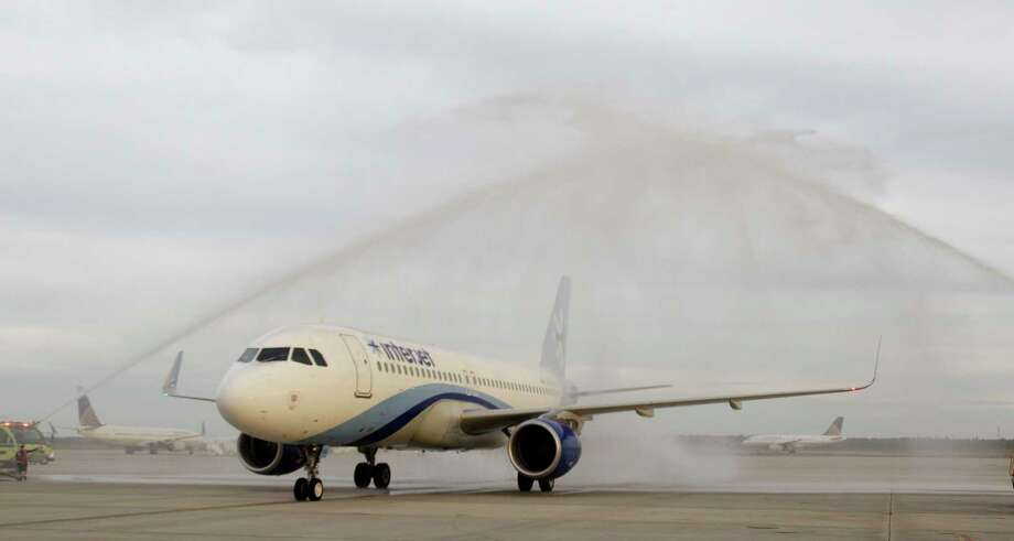 An Interjet plane is given a water cannon salute after its inaugural arrival at Bush Intercontinental Airport from Monterrey, Mexico Thursday, Oct. 23, 2014, in Houston.  ( Melissa Phillip / Houston Chronicle ) Photo: Melissa Phillip, Staff / © 2014  Houston Chronicle