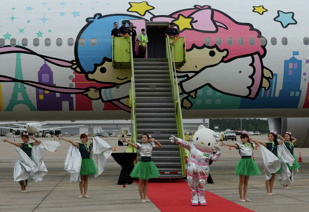 Hello Kitty dances for fans in front of EVA Air's Hello Kitty Shining Star Jet at an event celebrating its premiere Friday, June 19, 2015, in Houston. ( Jon Shapley / Houston Chronicle )