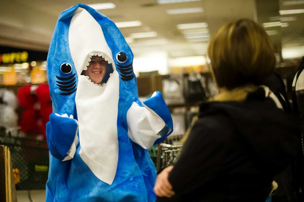 Alex Futter of Midland, 13, tries on a shark costume and shows it to his mom, Fay Futter, on Monday, Oct. 30, 2017 at The Halloween Store. (Katy Kildee/kkildee@mdn.net)