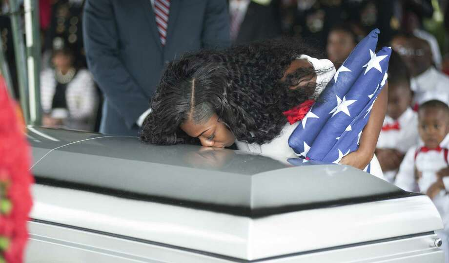 Myeshia Johnson as she kisses the casket of her husband, Army Sgt. La David Johnson. May we never forget that without the sacrifices of our troops and their loved ones, we would be a far different country. Photo: Gaston De Cardenas / Getty Images / AFP or licensors
