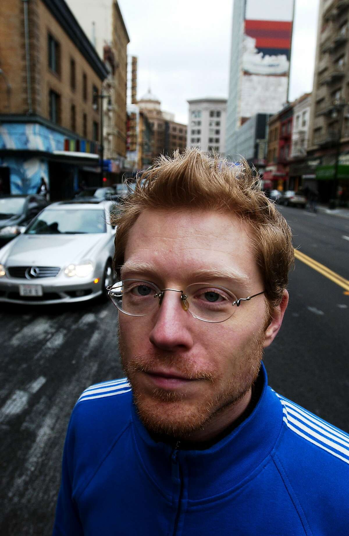 """Actor Anthony Rapp on Sixth St. in San Francisco CA Friday Feb. 17, 2006. Rapp came out of nowhere to work in a musical in development in 1996 that came to be called Rent. More recently he starred in the film version of the play, with many of the """"New York"""" scenes filmed on Sixth St. in San Francisco. Rapp has written a memoir called Without You, which is about the very emotional creation of Rent as well as his coping with his mother's terminal cancer. Victor J. Blue / The ChronicleRan on: 02-21-2006 Anthony Rapp, above, and top with his mother, older brother and sister, in a circa 1983 photo that appears in his memoir, Without You."""
