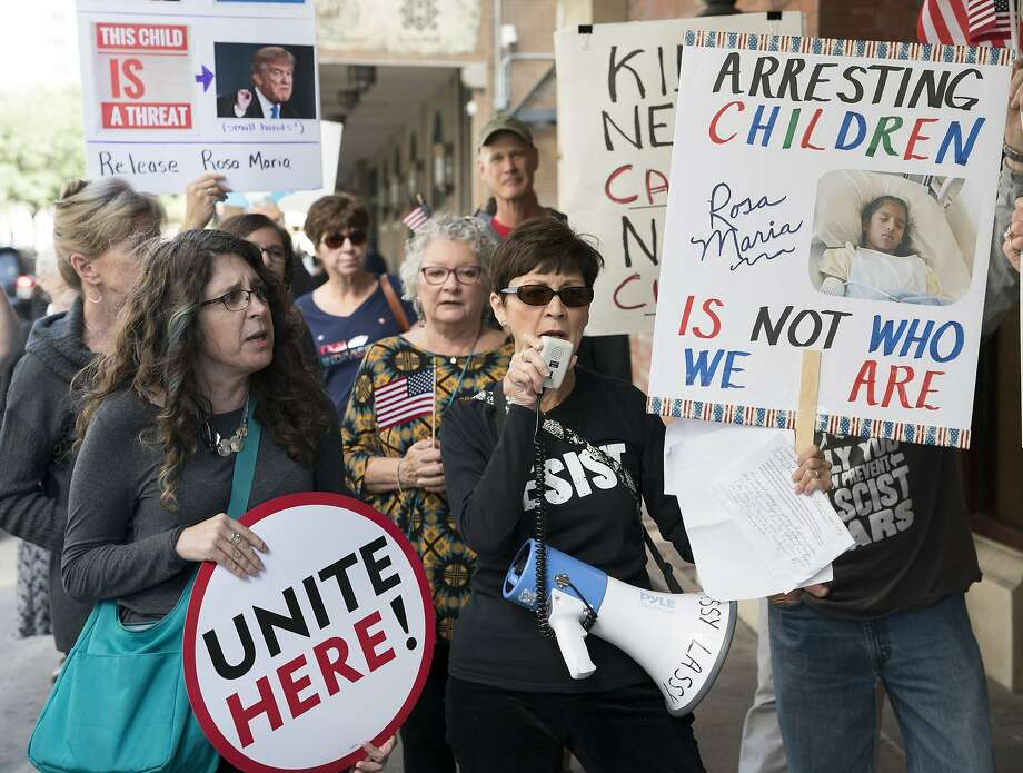 Phyllis Logan, center, leads protestors in chants calling for the release of Rosa Maria Hernandez, Monday, Oct. 30, 2017, in Downtown San Antonio. The protestors assembled outside of the office of sen. John Cornyn to call for the release of Rosa Maria Hernandez, a ten-year-old undocumented Mexican girl with cerebral palsy, who is being detained by ICE. (Darren Abate/For the Express-News) Photo: Darren Abate, San Antonio Express-News