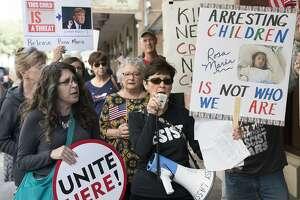 Phyllis Logan, center, leads protestors in chants calling for the release of Rosa Maria Hernandez, Monday, Oct. 30, 2017, in Downtown San Antonio. The protestors assembled outside of the office of sen. John Cornyn to call for the release of Rosa Maria Hernandez, a ten-year-old undocumented Mexican girl with cerebral palsy, who is being detained by ICE. (Darren Abate/For the Express-News)