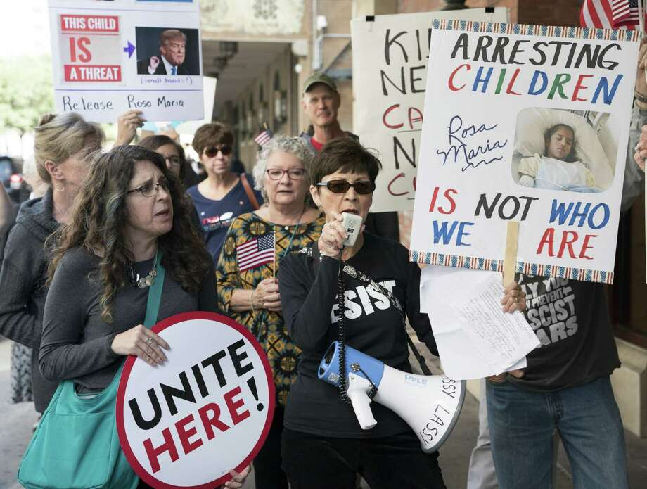 Phyllis Logan, center, leads protestors in chants calling for the release of Rosa Maria Hernandez, Monday, Oct. 30, 2017, in Downtown San Antonio. The protestors assembled outside of the office of sen. John Cornyn to call for the release of Rosa Maria Hernandez, a ten-year-old undocumented Mexican girl with cerebral palsy, who is being detained by ICE. (Darren Abate/For the Express-News) Photo: Darren Abate, FRE / San Antonio Express-News