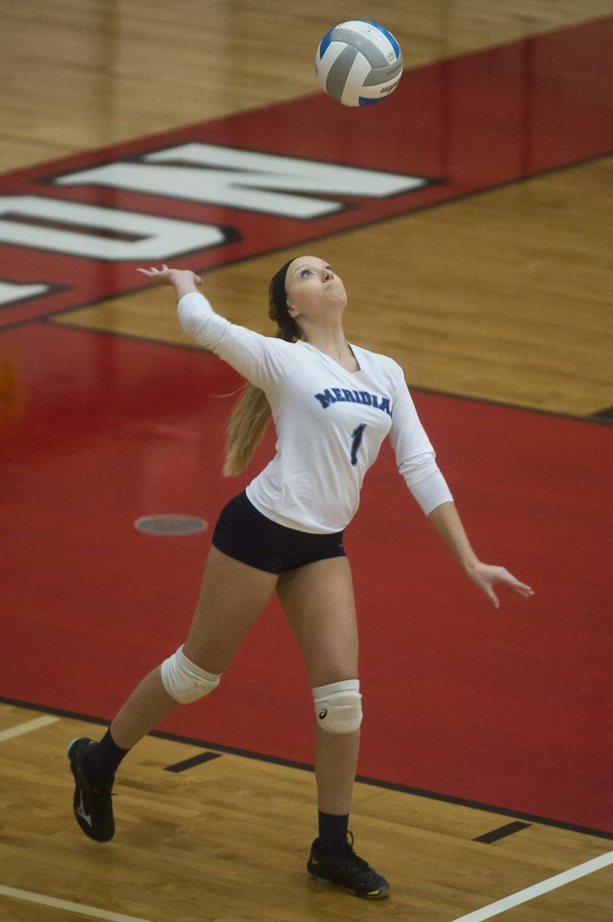 Meridian senior Kaylee LaVack serves the ball during a game against Pinconning on Monday, Oct. 30, 2017 at Beaverton High School. (Katy Kildee/kkildee@mdn.net)