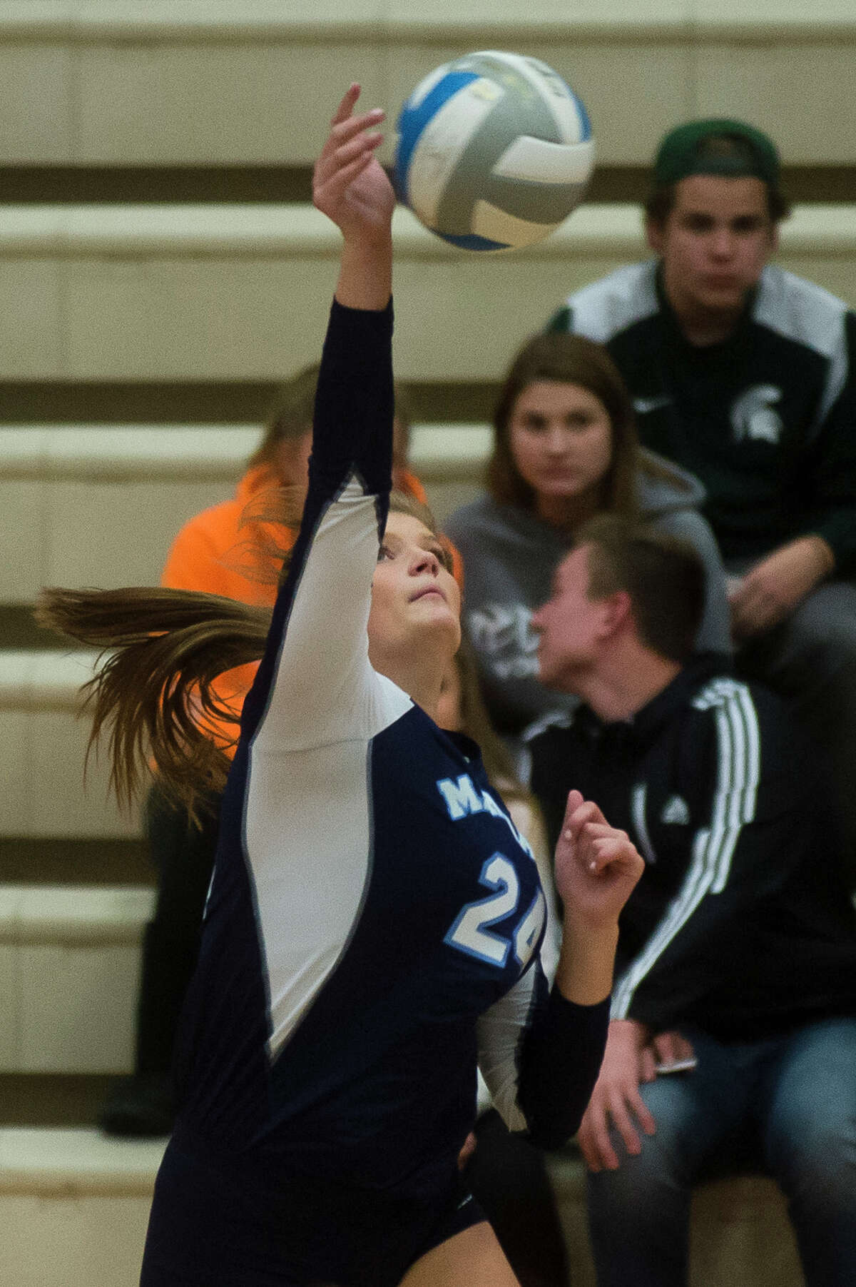 Meridian junior Baleigh Hill spikes the ball during a game against Pinconning on Monday, Oct. 30, 2017 at Beaverton High School. (Katy Kildee/kkildee@mdn.net)