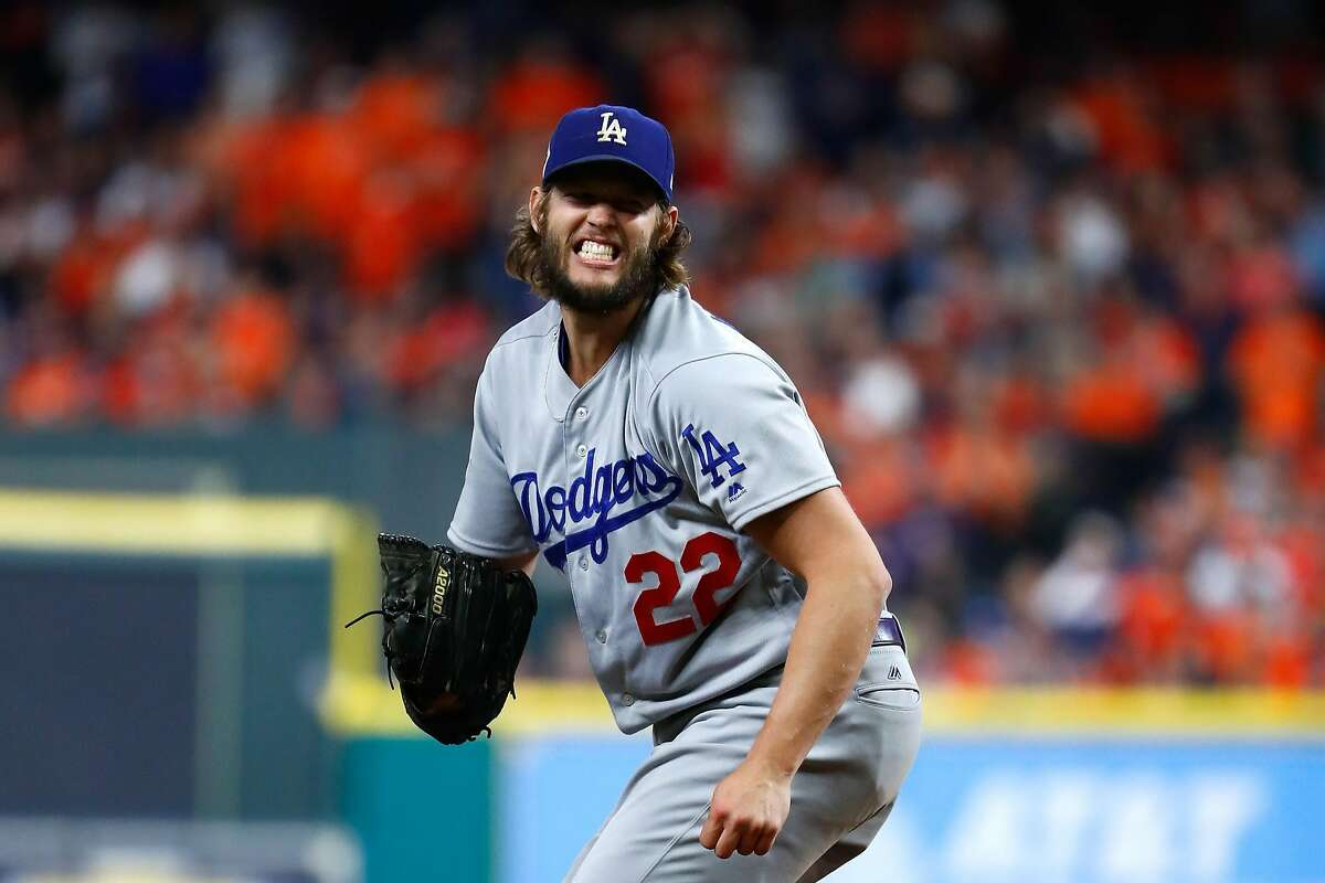 HOUSTON, TX - OCTOBER 29: Clayton Kershaw #22 of the Los Angeles Dodgers throws a pitch during the fifth inning against the Houston Astros in game five of the 2017 World Series at Minute Maid Park on October 29, 2017 in Houston, Texas. (Photo by Jamie Squire/Getty Images)