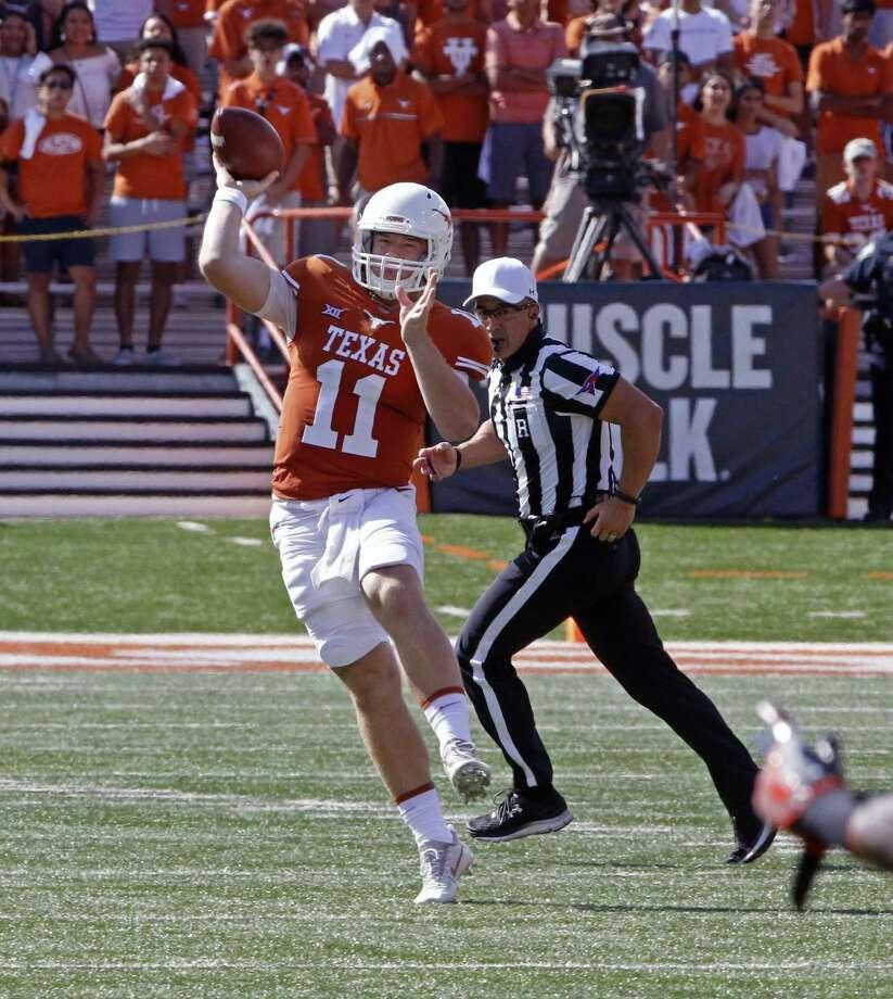 Longhorns quarterback Sam Ehlinger passes the ball against Oklahoma State on Oct. 21 in Austin. Photo: Michael Thomas /Associated Press / FR65778 AP