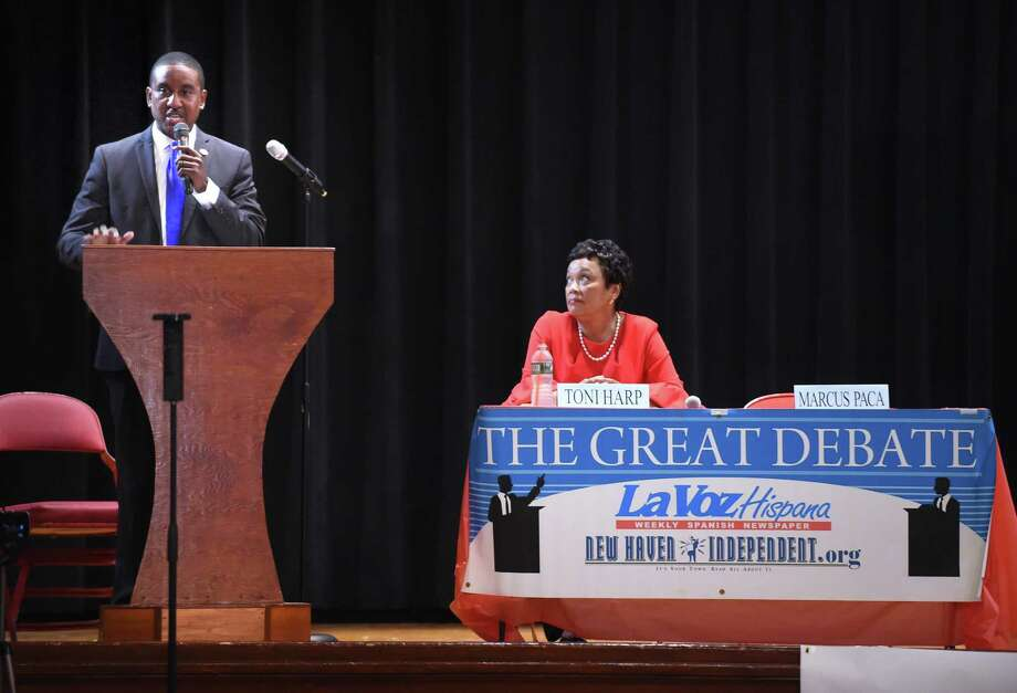 Marcus Paca (left) and New Haven Mayor Toni Harp (seated) participate in the Great Debate at Booker T. Washington Academy in New Haven on 9/5/2017. Photo: Arnold Gold / Hearst Connecticut Media / New Haven Register
