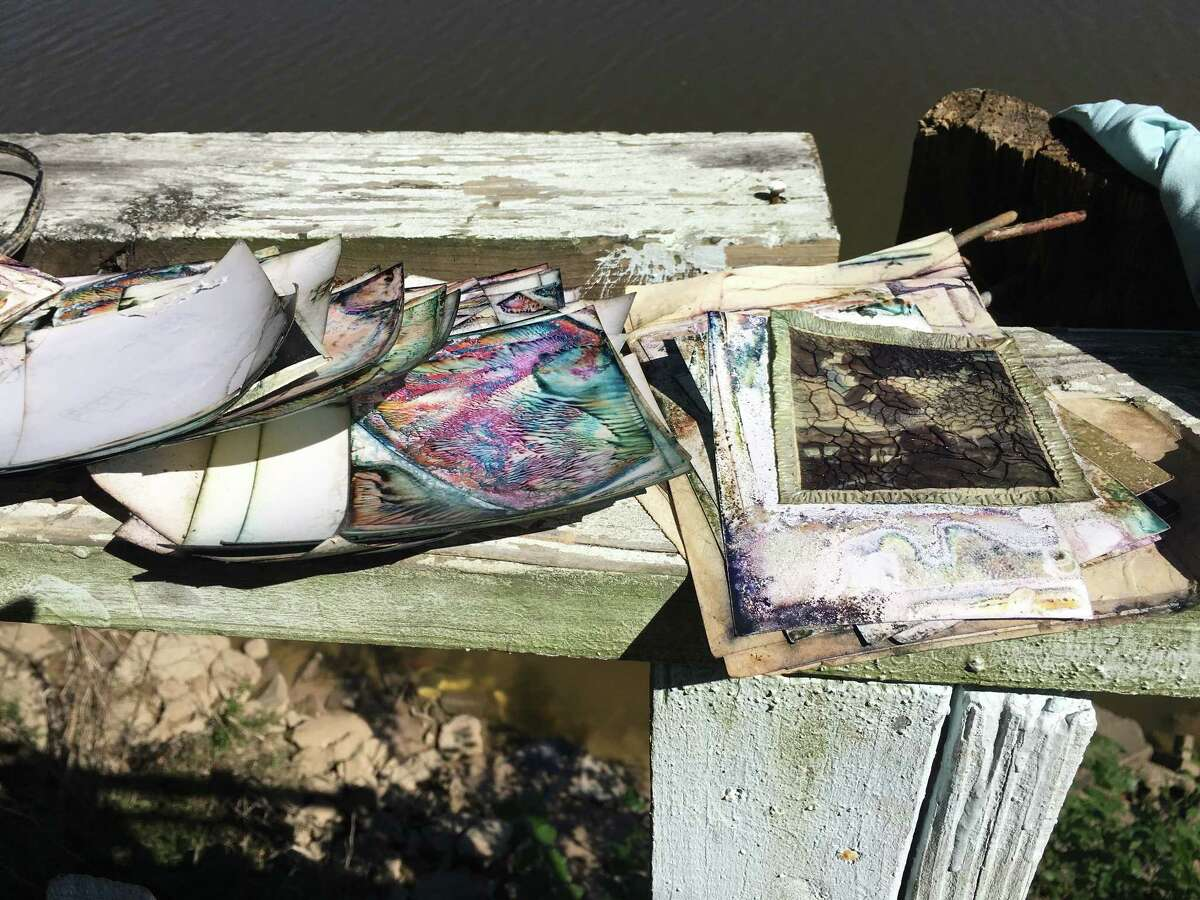 Photographs damaged by Hurricane Harvey were spread out to dry on the balcony of the home of David and Mike Friddle in the Banana Bend subdivision on the San Jacinto River.