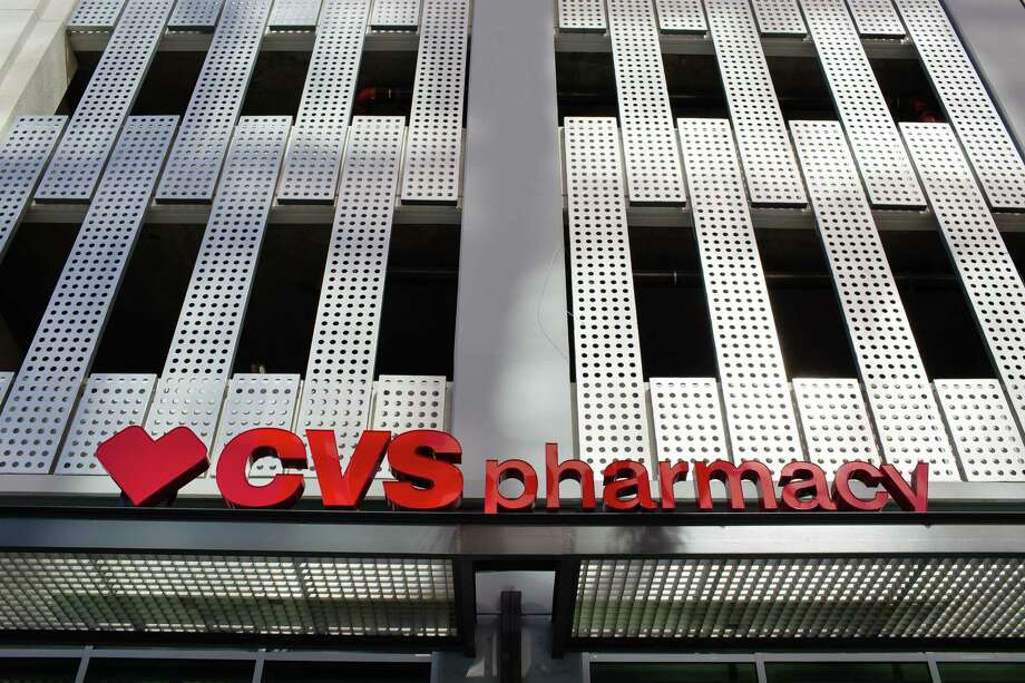 CVS Health Corp. signage is displayed outside a store in downtown Los Angeles, California, U.S., on Friday, Oct. 27, 2017. The prospect of Amazon.com Inc. entering the healthcare business is beginning to cause far-reaching reverberations for a range of companies, roiling the shares of drugstore chains, drug distributors and pharmacy-benefit managers, and potentially precipitating one of the biggest corporate merger deals this year. Photographer: Christopher Lee/Bloomberg ORG XMIT: 775066861 Photo: Christopher Lee / © 2017 Bloomberg Finance LP