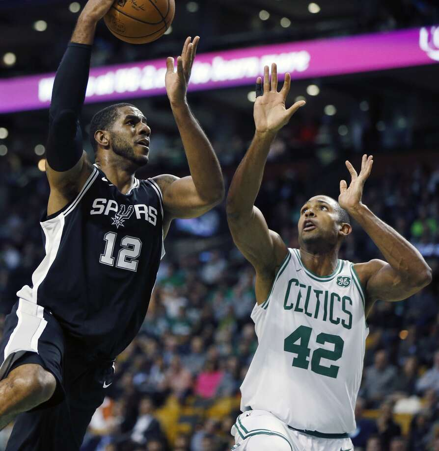 San Antonio Spurs' LaMarcus Aldridge (12) shoots against Boston Celtics' Al Horford (42) during the first quarter of an NBA basketball game in Boston, Monday, Oct. 30, 2017. (AP Photo/Michael Dwyer)