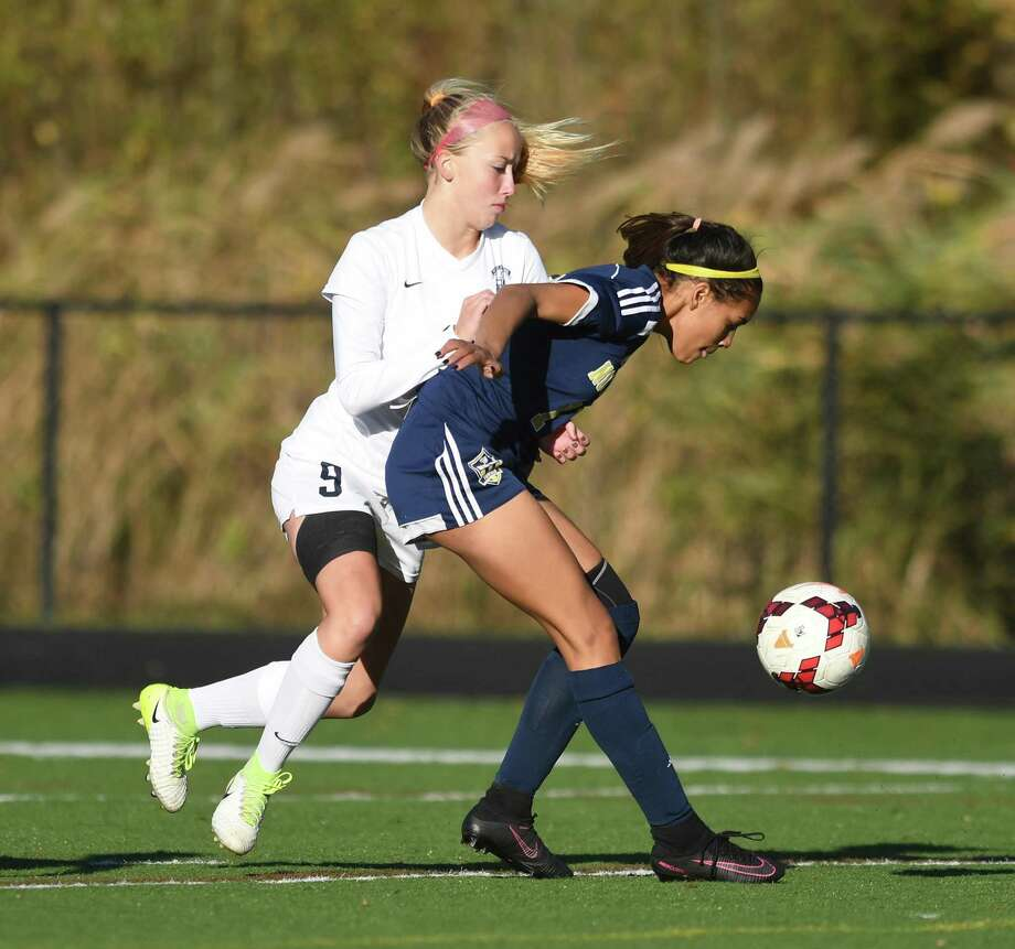 Immaculate player, Nicolette Stocks, left, and Notre Dame's Tassia Ferriera battle for the ball in the SWC semifinal girls soccer game between Notre Dame and Immaculate at Immaculate High, 10/30/17. Photo: Krista Benson / The News-Times Freelance