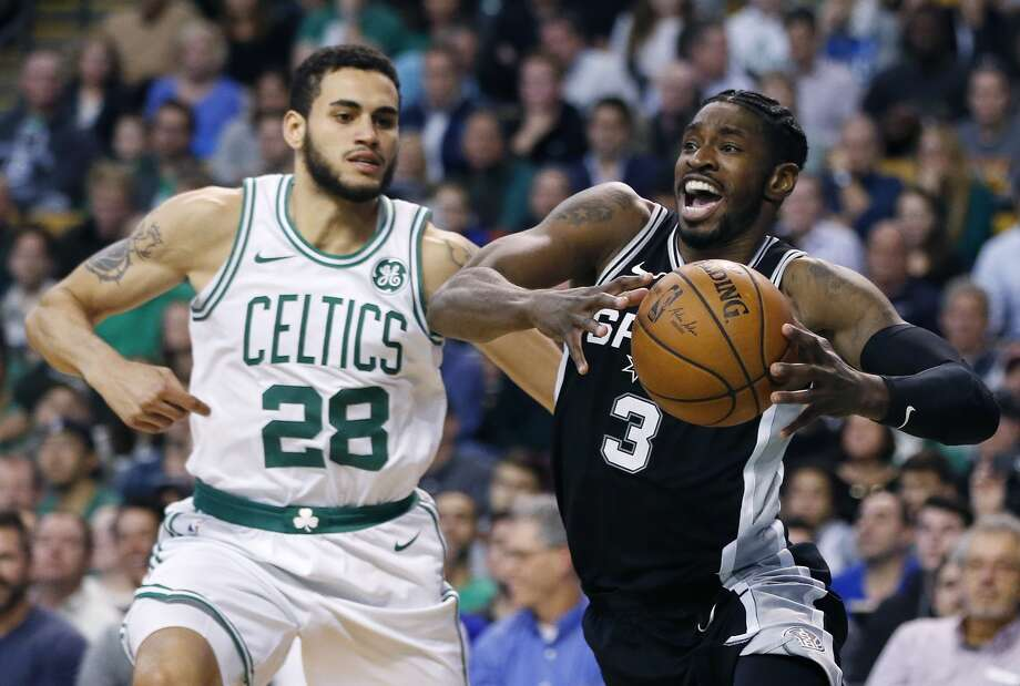 San Antonio Spurs' Brandon Paul (3) drives past Boston Celtics' Abdel Nader (28) during the second quarter of an NBA basketball game in Boston, Monday, Oct. 30, 2017. (AP Photo/Michael Dwyer)